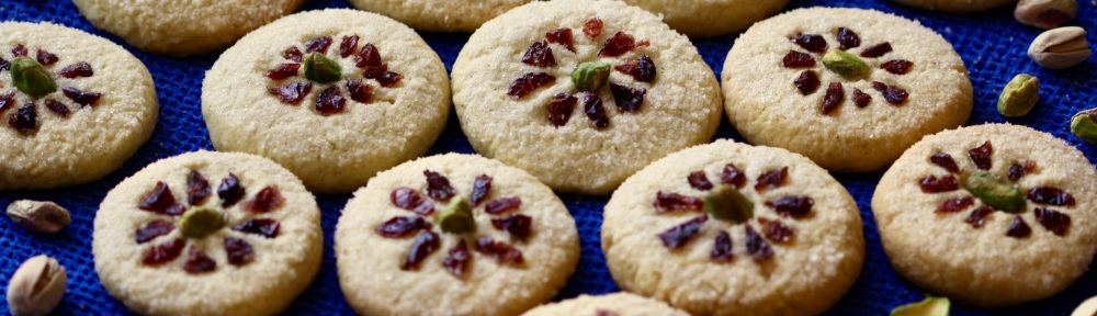Rice cookies decorated with pistachios and dried cranberries