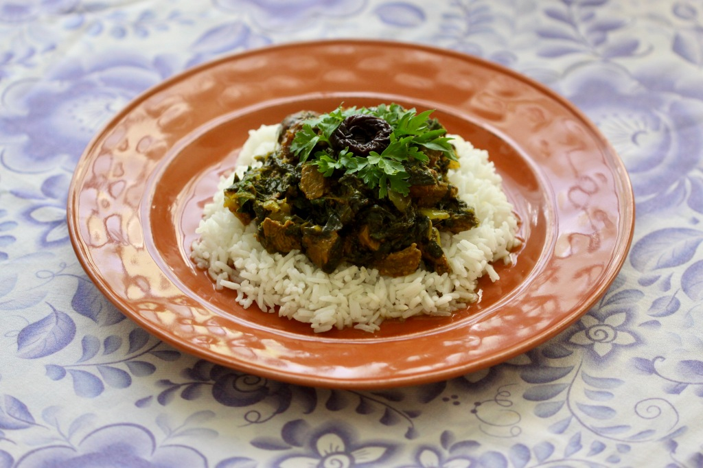 Spinach stew on rice